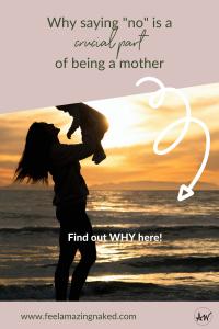 mom holding a baby on a beach